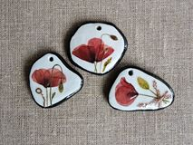 Handmade pendants from red poppy flowers Royalty Free Stock Image