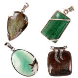 Pendants Set 2. A set of silver pendants having green jade, green onyx, jasper and labradorite stones. Used as jewelery or for alternative therapies, isolated on Royalty Free Stock Image