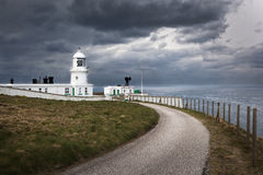 Pendeen lighthouse. Stormy skies over Pendeen Lighthouse, West Cornwall, UK royalty free stock photography