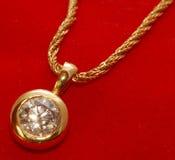 Pendente dourado fotografia de stock royalty free