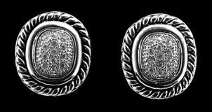 Pendientes de plata con los diamantes Fotos de archivo