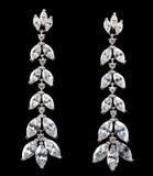 Pendientes de plata con los diamantes Foto de archivo libre de regalías