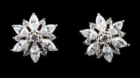 Pendientes de plata con los diamantes Fotografía de archivo