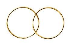 Pendientes del oro aislados en un fondo blanco Foto de archivo libre de regalías