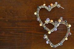 Pendientes en forma de corazón Fotografía de archivo libre de regalías