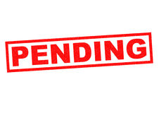 PENDING. Red Rubber Stamp over a white background Stock Images