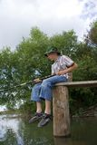 Pending when will peck. The boy waits when the fish will peck Stock Photo