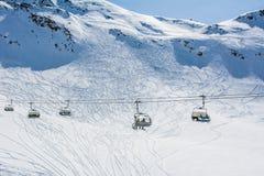 Pendio e cabina di funivia dello sci sulla stazione sciistica in Austria, alpi Immagine Stock Libera da Diritti