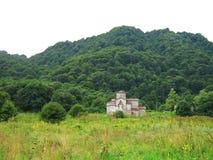 Pendio e castello di montagna Fotografia Stock