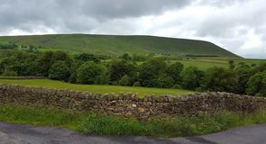 Pendle hill captured near moss reservoir. royalty free stock photo