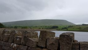 Pendle hill, lancashire. Pendle hill captured on the rainy summer day. Famous witch trail royalty free stock photos