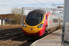 Pendolino train arriving at Carlisle station. Virgin Pendolino electric multiple unit train arriving at platform 3 at Carlisle on Friday 24th March 2017 with Royalty Free Stock Photos