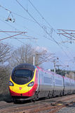 Pendolino Train on West Coast Main Line in Lancash Stock Photography