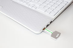 Pendrive, a laptop with the sentence contact us. Pendrive in a laptop with the sentence contact us Stock Images