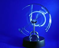 Pendulum. Perpetual motion pendulum on blue background stock photo