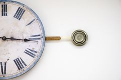 Pendulum clock. Closeup of a wall clock on its side with the pendulum as a target Stock Photo