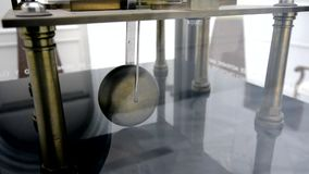 Pendulum clock ticking stock video footage