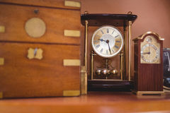 Pendulum clock watch on table. In workshop Stock Images