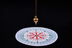 Pendulum for divination stock photography