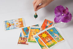 pendulum and divination card.   A pendulum and divination card stock image