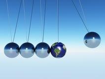 Pendulum. Earth between Newtons cradle Spheres Royalty Free Stock Photo