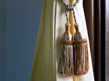 Pendulum gold thread. Stock Photo