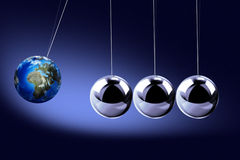 The pendulum of Newton as the Earth Royalty Free Stock Photos
