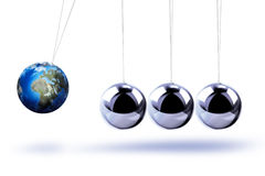 The pendulum of Newton as the Earth Stock Photo