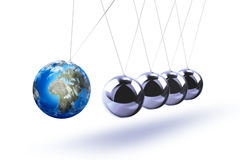 The pendulum of Newton as the Earth symbolizing the risk Royalty Free Stock Images