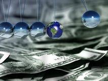 Pendulum. Newton pendulum. US dollars. One sphere represents Earth planet Stock Photo
