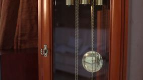 The pendulum of the old antique clock, Old wooden clock, antique clock. Old Time and Time Concept. The pendulum of the old antique clock, swinging from side to stock video