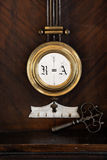 Pendulum of a old Clock with Key. Pendulum of a vintage Clock with Key Royalty Free Stock Photo