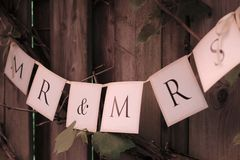 Pendulum with text. Paper garland with each flag a letter. Mr. and Mrs Royalty Free Stock Photos