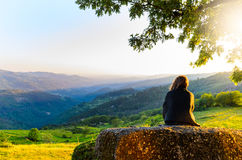 Peneda-Geres National Park. Scenic view of woman watching at sunset mountains, Peneda-Geres National Park, northern Portugal royalty free stock photography