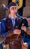 Penedono, Португалия/1-ое июля 2017 - укомплектуйте личным составом bagpi игр традиционное стоковое фото