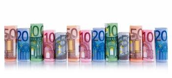 Pengar—sedlar i rad arkivfoton