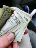 Pengar över allt royaltyfria bilder