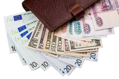 Dollar euros, ryss Robles i plånboken Royaltyfri Bild