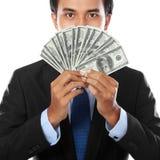 pengar för affärsholdingman arkivfoton