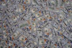 pengar för bakgrundsdollar mycket arkivfoto