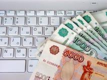 Pengar för datoren Arkivbilder