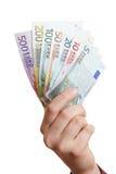 pengar för holding för euroventilatorhand Fotografering för Bildbyråer