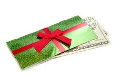 Pengar för jul på en vit bakgrund royaltyfria foton