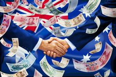 Pengar för Kina Australien investeringflagga royaltyfri foto