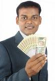 pengar för man för affärsholding indiska arkivbild