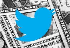 Pengar för Twitter symbolslogo arkivbilder