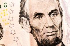 Pengar fem Lincoln Dollar Bill Arkivfoton