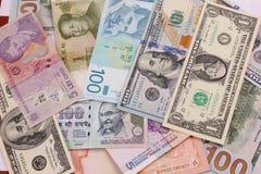 Pengar från all över världen Royaltyfri Bild