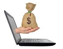 Pengar från datoren Royaltyfri Foto