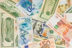Pengar från olika länder: dollar euro, hryvnia, rubel Arkivfoton